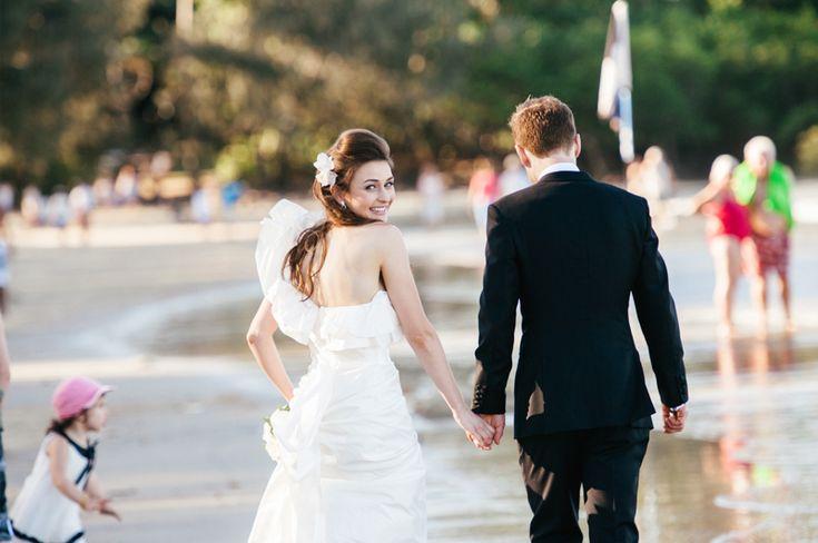 "Port Douglas Wedding Photography. Elise executing a perfect ""look back""on 4 mile beach in Port Douglas. Destination Wedding Photography."