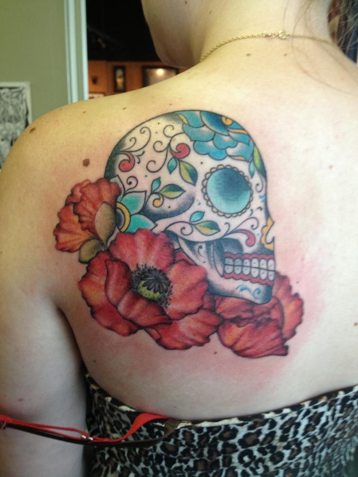 Sugar skull and poppy tattoo.