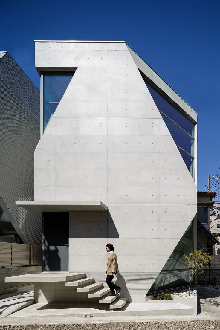 """This house is located in the center of Tokyo, on a site area of mere 66㎡. The clients are a married couple both working in the field of chemistry, sharing a passion for architecture and art. """"We want to see exposed concrete finish inside and out. A"""