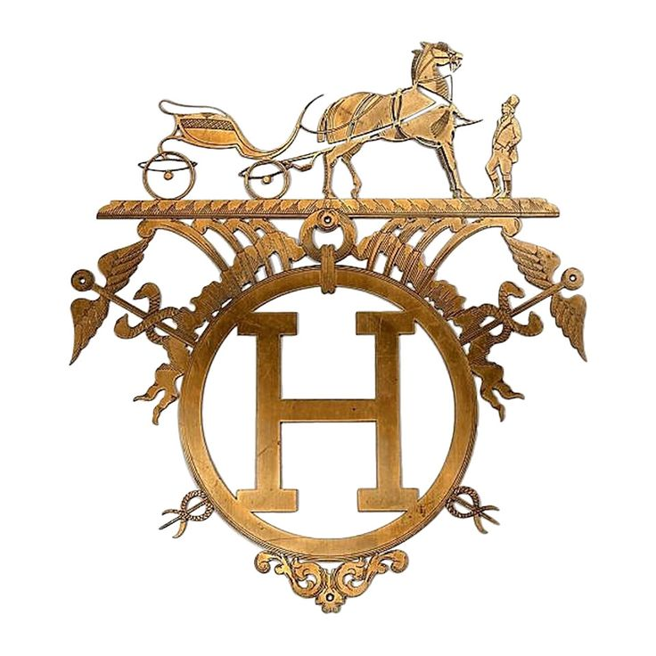 """A gilt brass Hermès boutique sign, openwork representing an """"H"""", with a harnessed Grand Duc and his horseman.  This Hermès sign comes from an Parisian Hermès store. Extremely rare and impossible to find. Perfect for an unique interior design."""