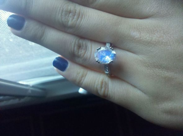 This ring would be perfect.This woman wanted a moonstone ring for her engagement ring. She found this 3 carat faceted stone and worked with a jewelers to put it in this setting. Antique stores are also an option since moonstone engagement rings were more common back in the day.