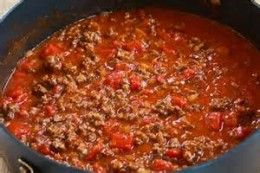 Add tomato paste and then diced tomatoes - Chili without beans for those who don't eat them.