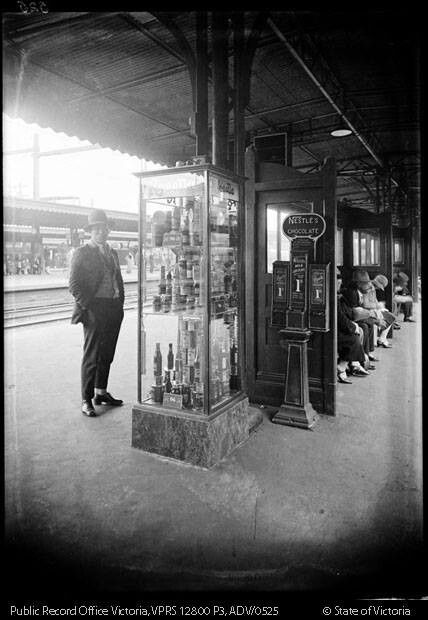 Flinders St 1920s with Nestle chocolate vending machine.