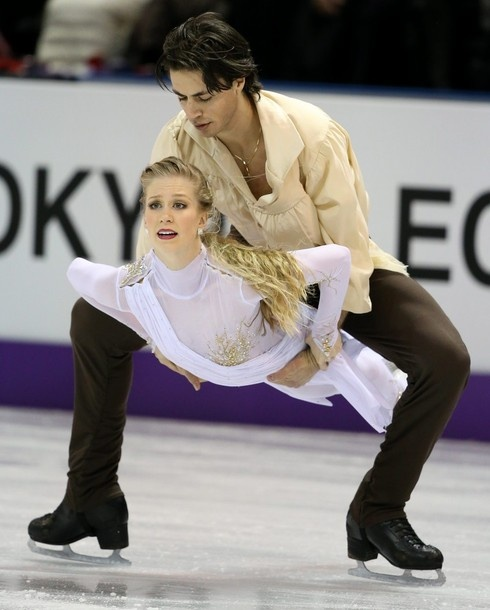 Kaitlyn Weaver and Andrew Poje, of Canada, perform their free dance in the ice dance competition at the World Figure Skating Championships, Saturday, March 16, 2013, in London, Ontario.