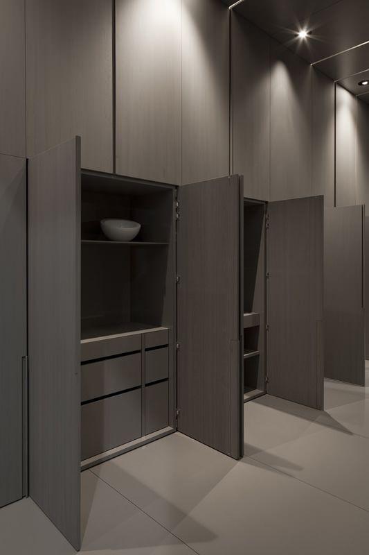 Grey-washed Oak flush cupboards...always chic,perhaps add brass handles or gold handles .......