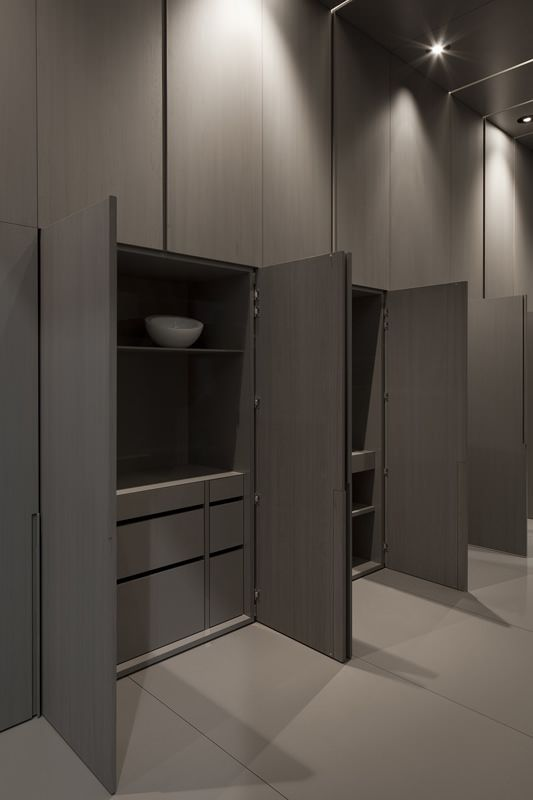 Grey-washed Oak flush cupboards...always chic,perhaps add brass handles or gold handles .......