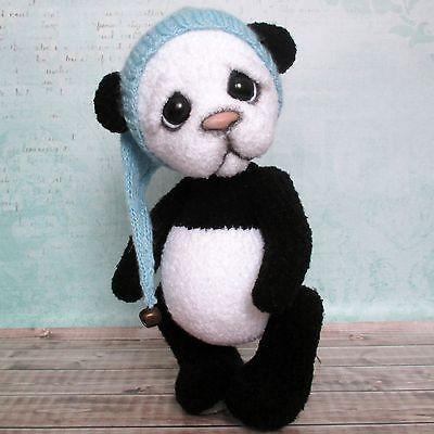 Handmade crochet panda in a blue cap, artist teddy bear, 10 1/3in.