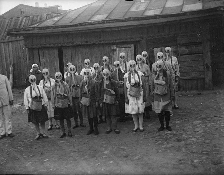 Group of girls wear their gas-masks during a gas drill (emergency response exercise with gas masks). Moscow , 1930's