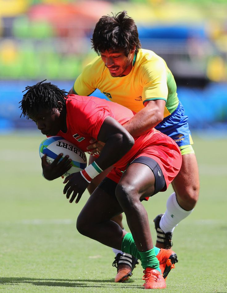 Augustine Lugonzo of Kenya is tackled by Moises Duque of Brazil during the Men's Rugby Sevens placing 11-12 match between Brazil and Kenya on Day 6 of the Rio 2016 Olympics at Deodoro Stadium on August 11, 2016 in Rio de Janeiro, Brazil.