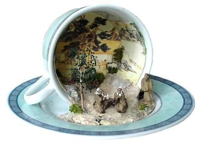 A miniature scene with an Asian theme whimsically set in an overturned      teacup