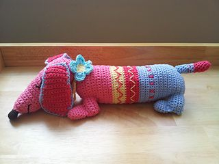 Ted the Dachshund by Rico Design - his pattern is available for free.free only in English at Knitting Magazine.Sold as a crochet kit with all yarns, hook and this pattern included.No gauge listed in the pattern. For more information, see: http://www.craftsinstitute.com/knitting/projects/kids/toys/dachshund-ted.aspx