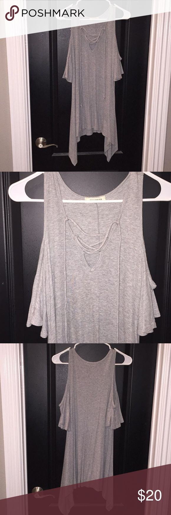 Gray Cold Shoulder Top, Sz M Long gray cold shoulder top with lace up neck line in size medium. Shirt has been worn once. Is from a boutique. Goes longer on the sides. Fits loose at bottom and tighter in chest area. It's a very soft and stretchy T-shirt like material, very comfortable! Promesa Tops Tees - Short Sleeve