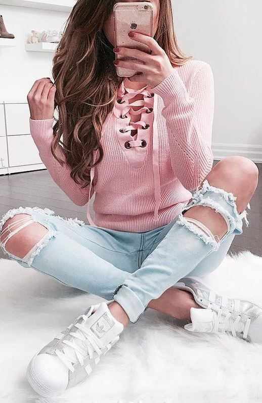 cool outfit idea | pink lace up sweater +distressed jeans + sneakers