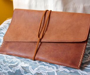 This leather clutch is a great project for a beginner to working with leather. Even if you have experience, this is still a beautiful and simple clutc...