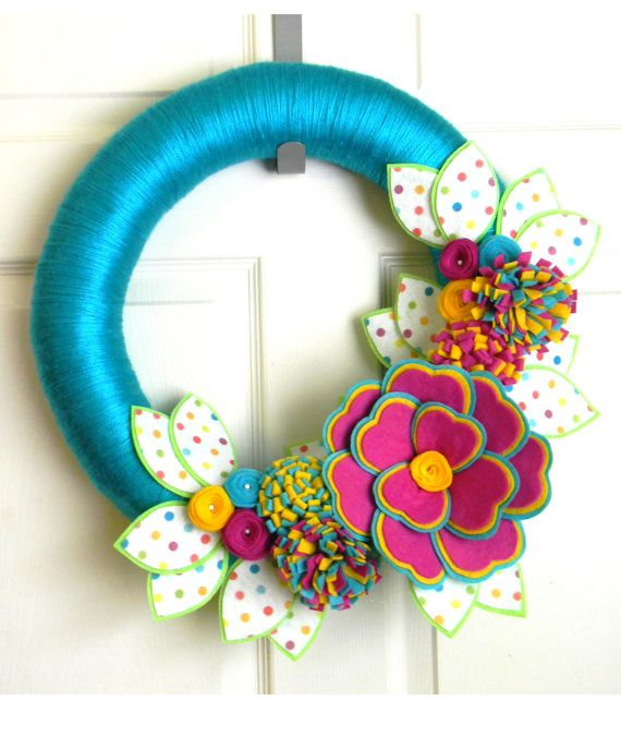 Hey, I found this really awesome Etsy listing at https://www.etsy.com/listing/179061595/confetti-16-inch-felt-and-yarn-wreath