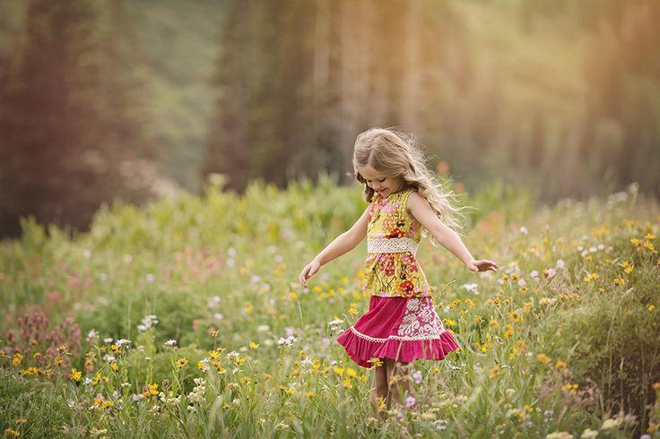 beautiful little girl dancing in a field of flowers | 1100 ...