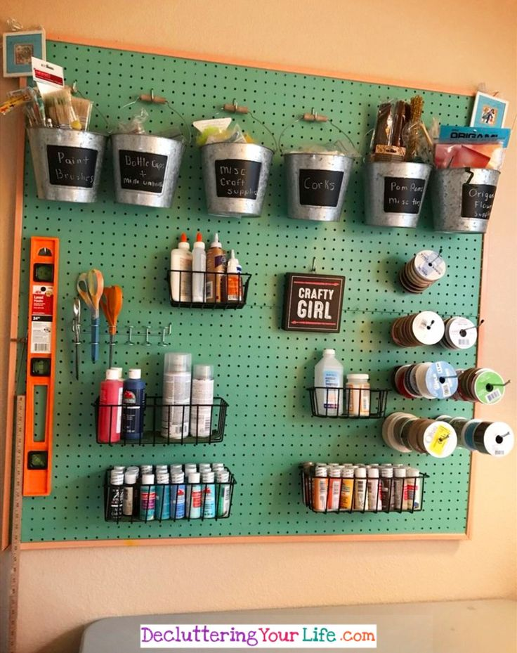 Craft Room Wall - This simple pegboard makes it SO easy to keep my craft supplies organized - Craft Room Organizing Ideas