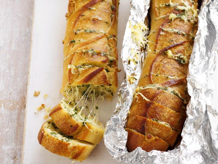 Cheesy Garlic Baguettes Recipe Appetizers with mozzarella cheese, parmesan cheese, butter, parsley, garlic, baguette, paprika