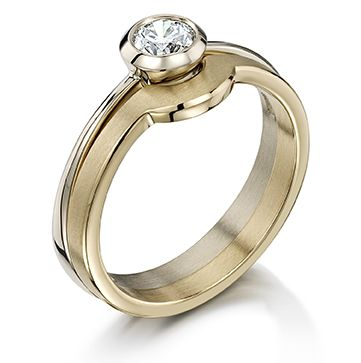 Two tone set, a diamond set white gold engagement ring fitted with a yellow gold band- we are quite in love!