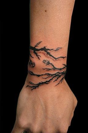 Tree branch wrap around wrist tattoo idea