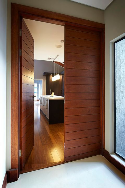 Building a modern home ? modern architecture is characterized by simplification, choose doors with clean strong horizontal lines. Doors and gate below were custom made to clients specifications.