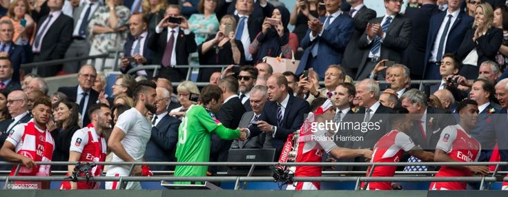 May 27th 2017, Wembley Stadium, London England; FA Cup Final, Arsenal versus Chelsea FC; His Royal Highness The Duke of Cambridge Prince William presenting a winners medal to Arsenal Goalkeeper David Ospina