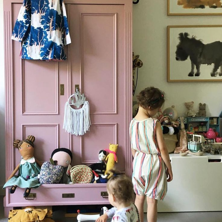 Sophisticated and whimsical girls room- pink armoire