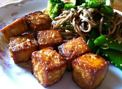 How To Prepare Extra Firm Tofu: instructions to drain and recipe for a marinade inside; baked at 350 for 50 minutes, flipping halfway. Broil for a few minutes to get extra crispy.