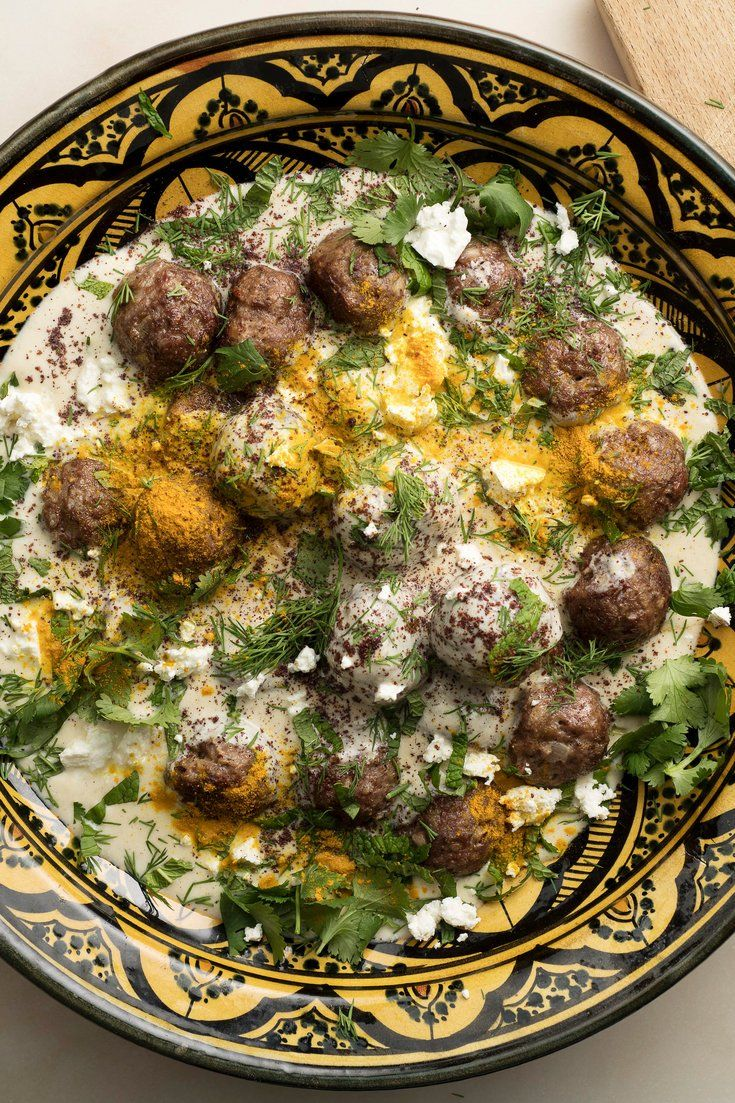 "NYT Cooking: These spice-loaded meatballs have a Turkish inflection. The warm yogurt sauce adds tang and richness, along with a sprinkling of tart sumac powder and chopped mint. American ""Greek-style"" yogurt is not always tart enough, but it can be thinned with a bit of buttermilk or even lemon juice. Whisking it with cornstarch and egg produces a silky sauce. Though the ingredient list looks long, this is ..."