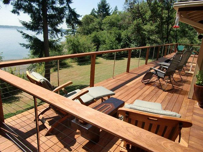 Deck railing idea -  With a flat top, the rails double as a food or drink ledge.  The view remains unblocked with thin cable rail inserts.