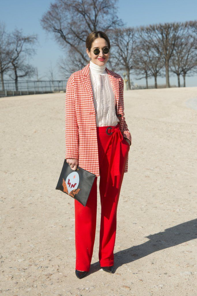 Cute red plaid coat with red pants. Paris fashion week street style.
