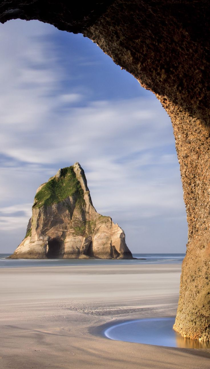 Wharariki Beach, South Island, New Zealand....I think this is the beach that was near where that shark was being caught by fishermen but then at the same time being eaten by a bigger shark...eeee....