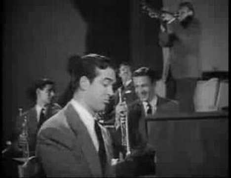 "Glenn Miller - In The Mood.  This is a scene from ""Orchestra Wives"", the o only movie Miller appeared in (he's playing the lead trombone).  But pay close attention when the camera switches from Miller to the pianist - the guy playing the piano looks like the same guy who played  Fred Gailey (the lawyer who represented Santa Claus) in ""Miracle on 34th Street""..could it be he?"