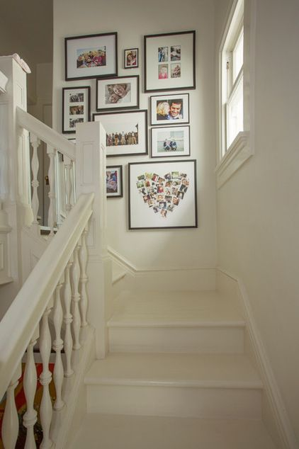 What a great idea - tiny prints of family pics shaped into a heart. ~ Eclectic Staircase by Margot Hartford Photography