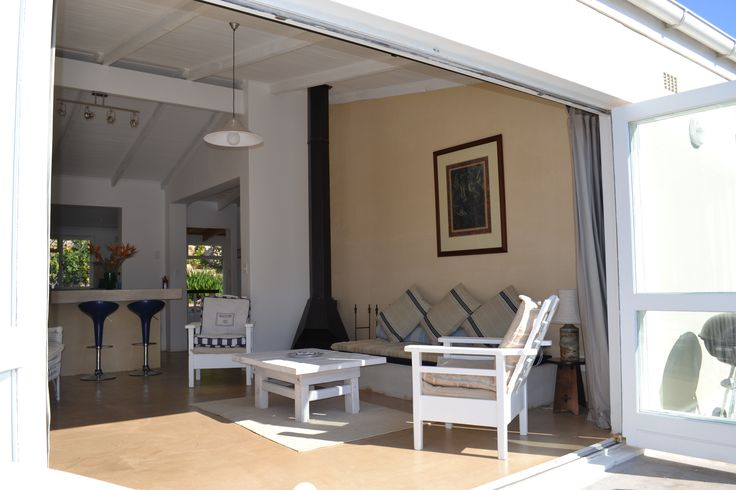 Self catering accommodation, Glencairn, Cape Town   French doors opening up from the lounge. Summer sunshine!  http://www.capepointroute.co.za/moreinfoAccommodation.php?aID=391