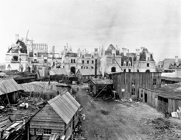 Biltmore Estate   May 8, 1894, about 1.5 years before the Christmas 1895 completion date requested by George Vanderbilt.  Visible in the center is the blacksmith shop, with its tall smokestack.  Directly behind the shop is a construction office, to its right is the masonry workshop of James Sinclair and Company.  Derricks for lifting heavy material were scattered across the job site.