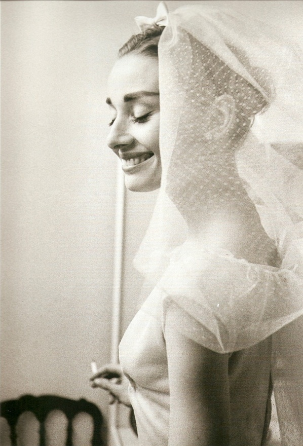 Audrey Hepburn with her #wedding #veil - via Once Wed. Lovely photo of Audrey!