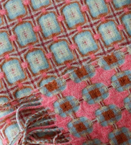 Beautiful colorful throw in check pattern in blues and reds.  Bottom part of the picture is the reverse side.