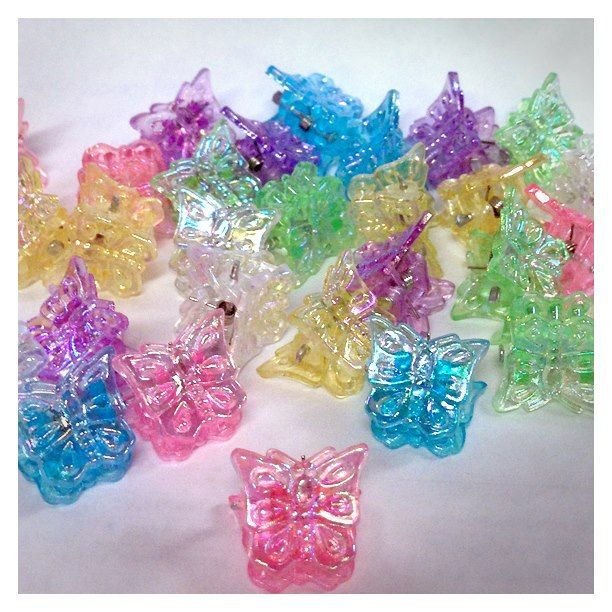 Butterfly clips.  Hahaha! I used to rock these all the time.