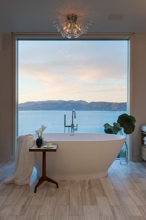 Water Front Home Boasts A Restful Bathroom Featuring A Floor To Ceiling Picture Window