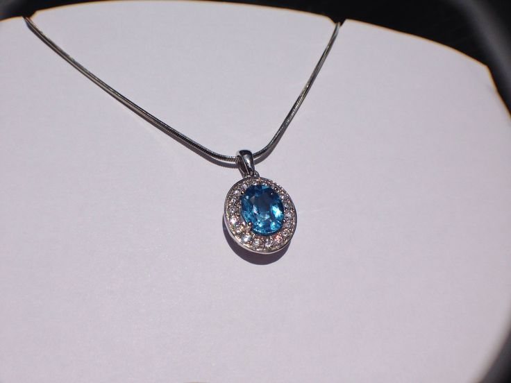 Pave design with a Blue Topaz stone.