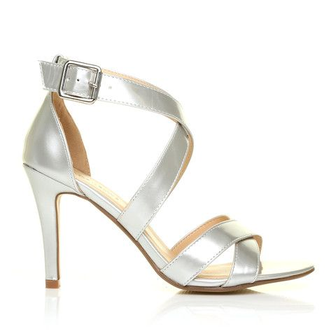SOPHIE Silver Metallic Strappy High Heel Sandals – ShuWish UK - Ultra sleek and oh so chic, the SOPHIE Silver Metallic Strappy High Heel Sandals make a bold statement but still mix and match with so many colours with the utmost of ease. Outfitted with 3.5-inch heels, these sexy vegan leather sandals have X straps at the toes and a second set of straps at the ankles that is finished with a matching silver buckle.