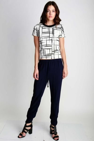 SHORT SLEEVED ABSTRACT/GRID PRINTED TOP WITH BACK ZIPPER DETAIL