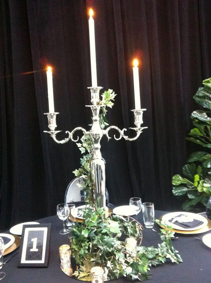 Candelabra with faux ivy Presented on mirror base and tea lights