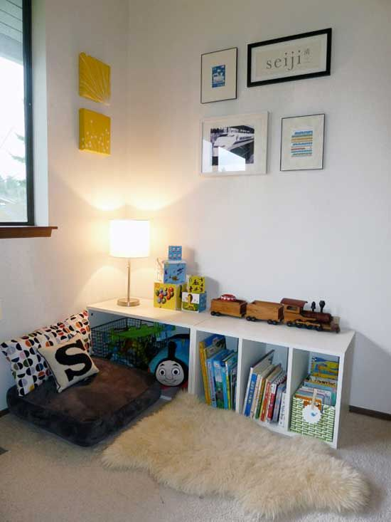simple kids reading nook  with pillows and rug