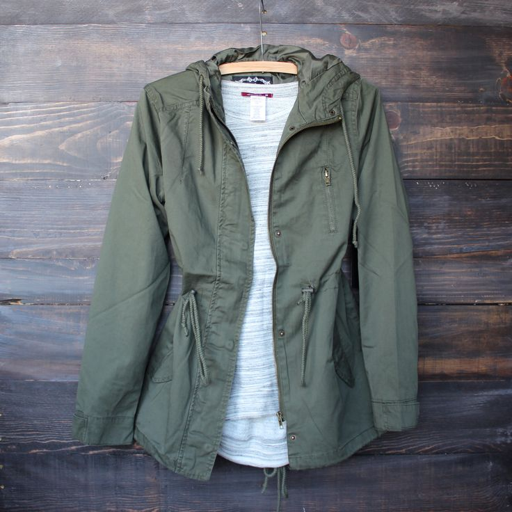 gorgeous army green parka jacket with functional pockets and zippers. Fully lined. Imported. - arm hole runs a bit snug, recommended to size up if in between sizes. - shown with our los cabos tank in
