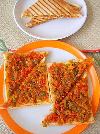 Iyengar Bakery Style Vegetable Masala Toast is an easy Indian food snack or breakfast fare that is quick to prepare. Vegetables are sauteed in spices and spread over toasted bread.