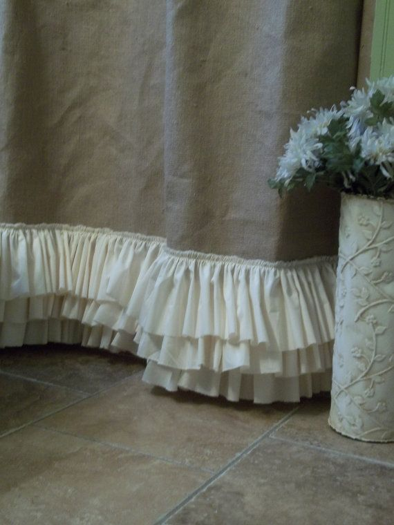 Rustic, Shabby and Beach decor all rolled in to one shower curtain. Natural Tan burlap accented with three rows of tattered ruffles. 72 x 72 Standard Shower Curtain Size 73 long up to 84 long - this is a range you are purchasing 85 long up to 96 long - this is a range you are purchasing PLEASE SPECIFY EXACT LENGTH WANTED DURING CHECKOUT Plastic Liner not included, but recommended Spot clean only, spritz with febreze to freshen.