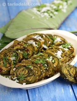 Patra, fame is not easily earned, and if this recipe is so popular, it must be because it combines those rare qualities of flavour and good health! colcocasia leaves are very nutritious as well as tasty, especially if made into patra – a smooth paste of besan with spicy, sweet and sour flavours is applied over the leaves, rolled and steamed. This requires skill and practice; however, it is easy once you start doing it. You can also make mini patras by using small leaves to make small rolls…