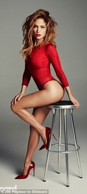 Going sheer: Lopez showed off her amazing figure in the skin-tight leotard while seated on...